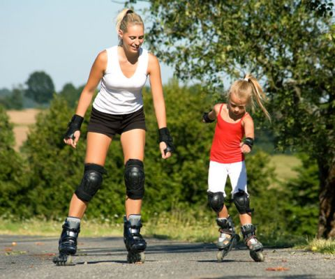 mother and child roller-blading