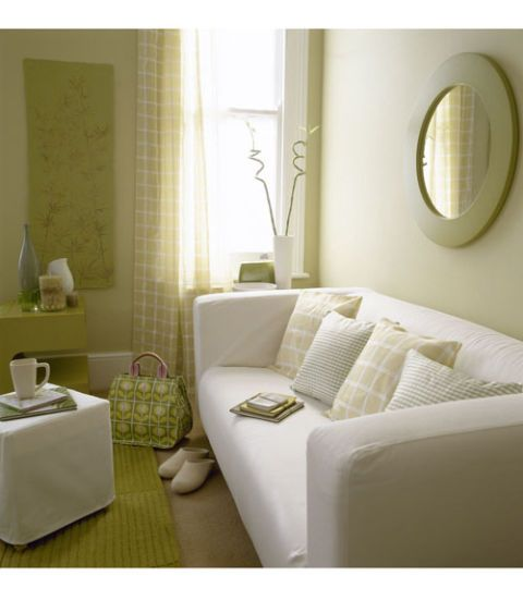 white and green living room with simple decor