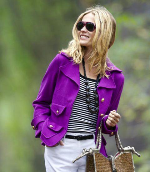 woman wearing bright blazer and sunglasses