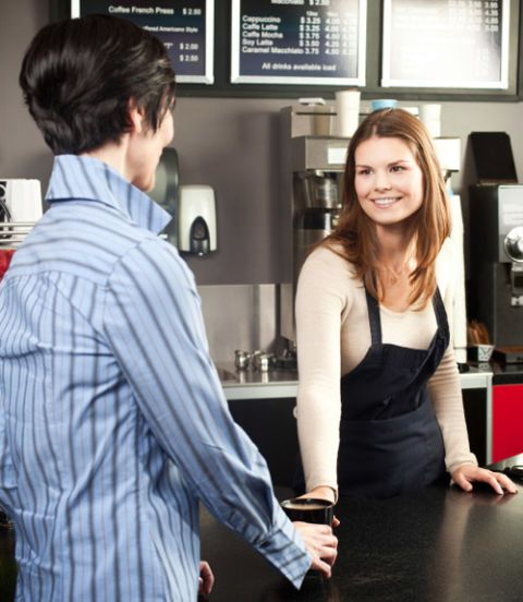 woman buying coffee