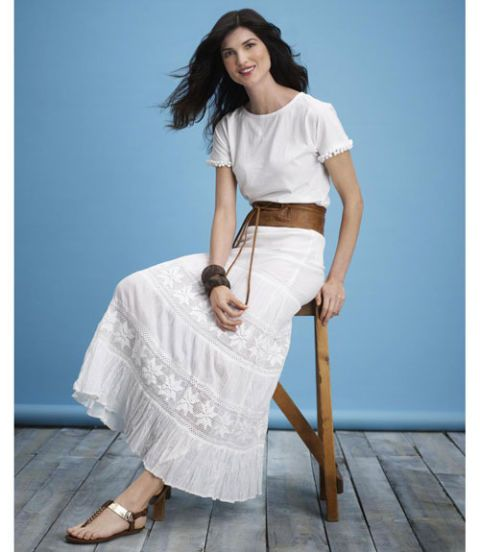 woman in white tee and bohemian skirt
