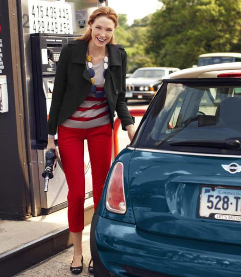 woman pumping gas in tuxedo jacket