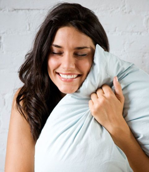 Girl hugging pillow