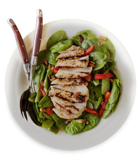 grilled chicken salad on a plate with utensils