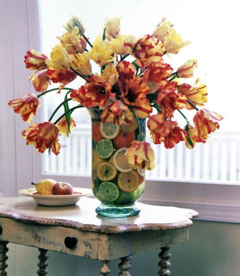 tulips and citrus fruit arrangement