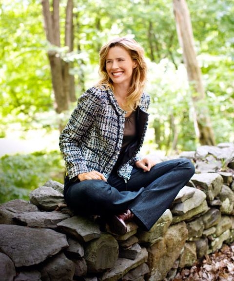 woman in plaid boucle jacket