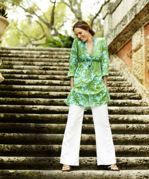 green tunic and white pants