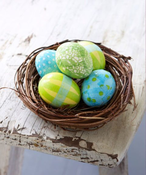 nest of dyed eggs layered with tissue paper