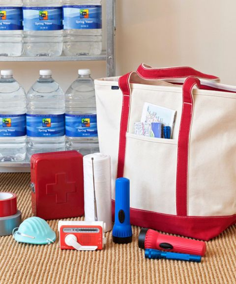 tote bag with emergency items water flashlights first-aid