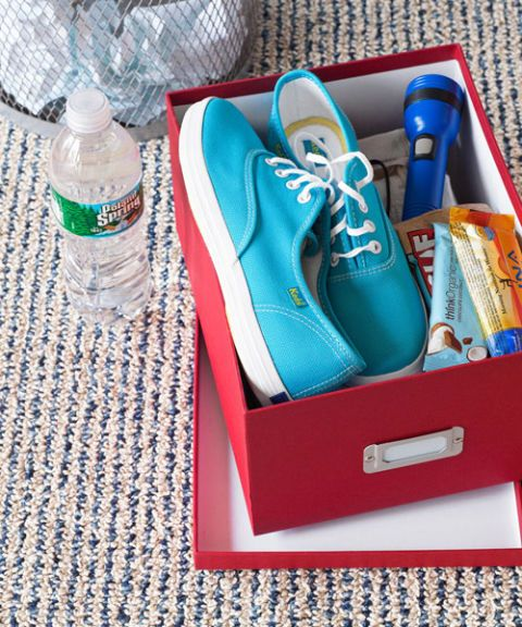 sneakers in box with emergency items
