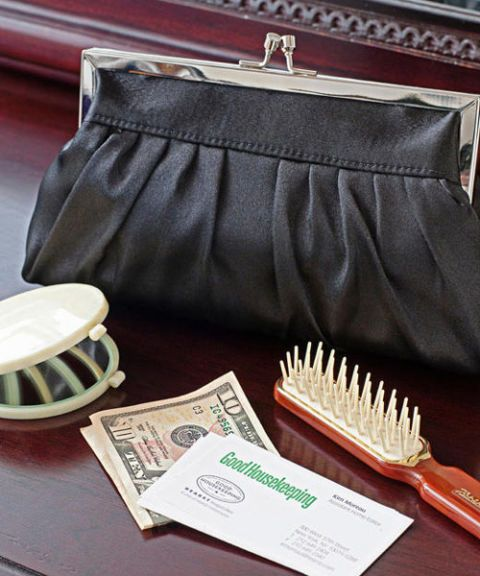 black purse, brush, dollars, business card