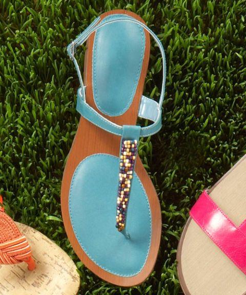 blue beaded sandals on green grass