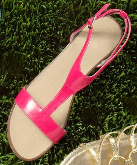 pink t-strap sandals on green grass