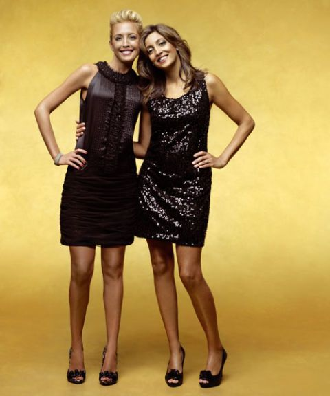 two women posing in black dresses