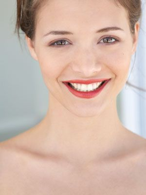 woman smiling with red lips from lipstick