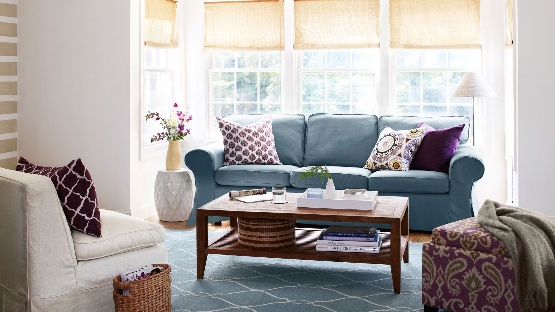 blue couch with throw pillows and coffee table in living room
