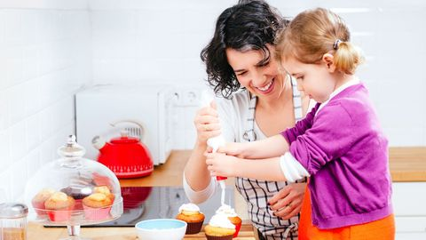 mother baking with daughter