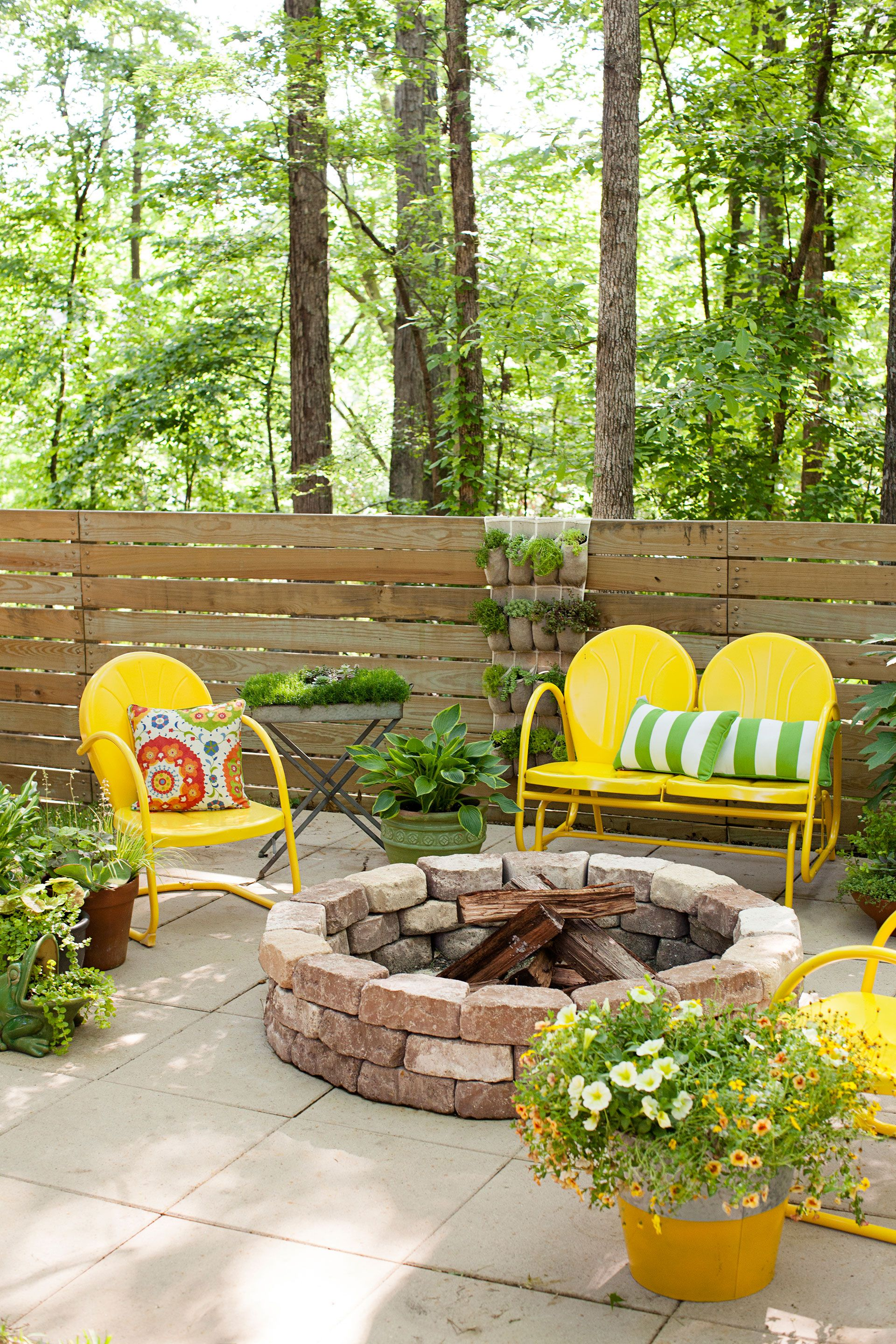 patio with fire pit and yellow chairs