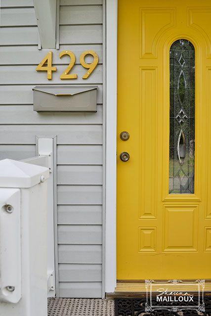 Yellow, Door, Home door, Fixture, Door handle, Household hardware, Handle, Number, Dead bolt, Paint,