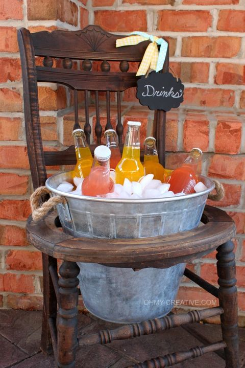 Bottle, Brick, Orange, Glass bottle, Brickwork, Peach, Distilled beverage, Building material, Barware, Home accessories,