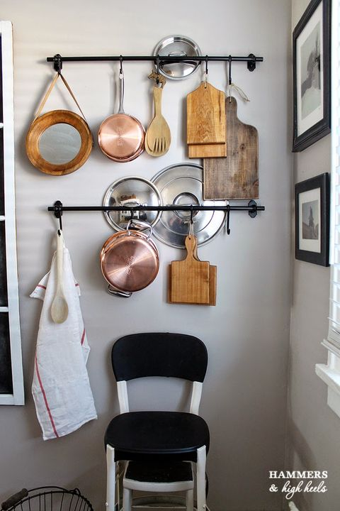 Room, Wall, Chair, Interior design, Pot rack, Picture frame, Interior design, Metal, Iron, Clothes hanger,