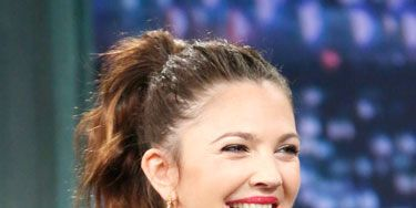 Ear, Jewellery, Hairstyle, Mammal, Earrings, Fashion accessory, Facial expression, Fashion, Necklace, Long hair,