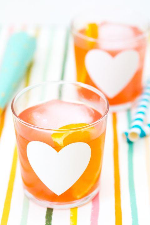 Liquid, Orange, Drink, Drinkware, Amber, Alcoholic beverage, Juice, Ingredient, Barware, Peach,