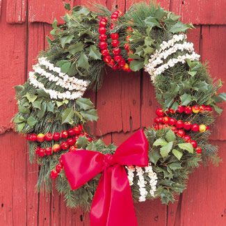 Christmas or holiday wreath decorated with cranberries and popcorn