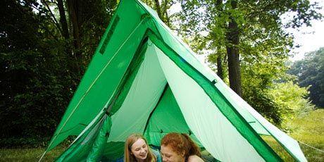kids in a tent in the backyard