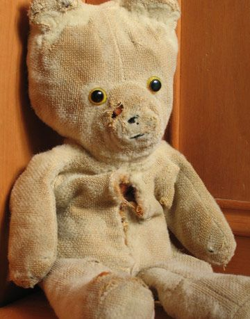 worn out teddy bear, stuffed animal