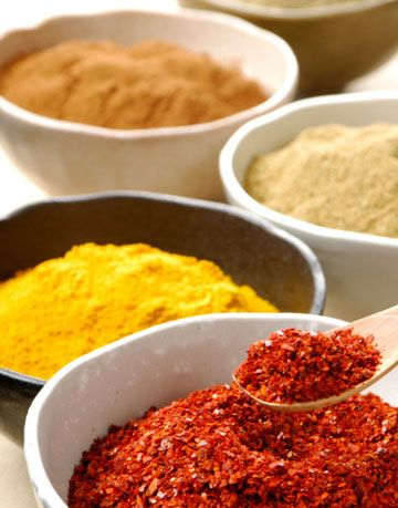 bowls of brightly colored spices