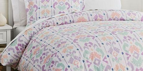 Room, Interior design, Green, Property, Textile, Wall, Furniture, Pink, Linens, Bedding,