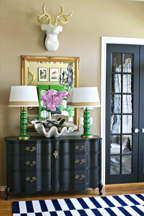 Room, Drawer, Deer, Antler, Interior design, Furniture, Cabinetry, Wall, Floor, Flooring,