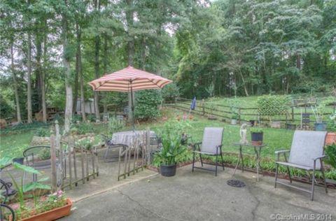 Plant, Garden, Furniture, Outdoor furniture, Shade, Shrub, Flowerpot, Yard, Backyard, Groundcover,