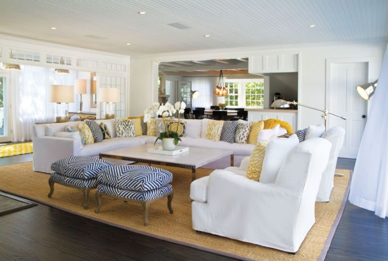 living room with white couch and yellow accents