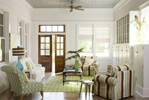 living room with open doors and windows