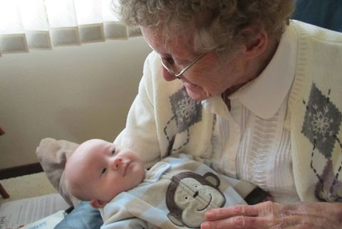 great grandmother holding baby
