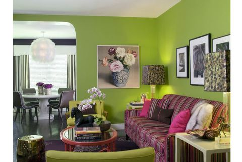 green walls and brightly patterned couch