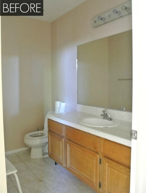 Builder Grade Bathroom And Feel Defeated That Bland Rectangular Mirror Boring Beige Walls Simple Countertop Honey Colored Wood