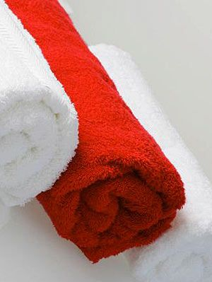 red and white towels in bathroom