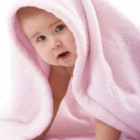 Baby in pink towel