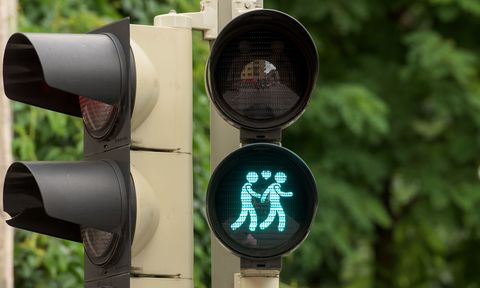 Green, Light, signaling device, Sign, Signage, Circle, Gas, Symbol, Street sign, Traffic light,