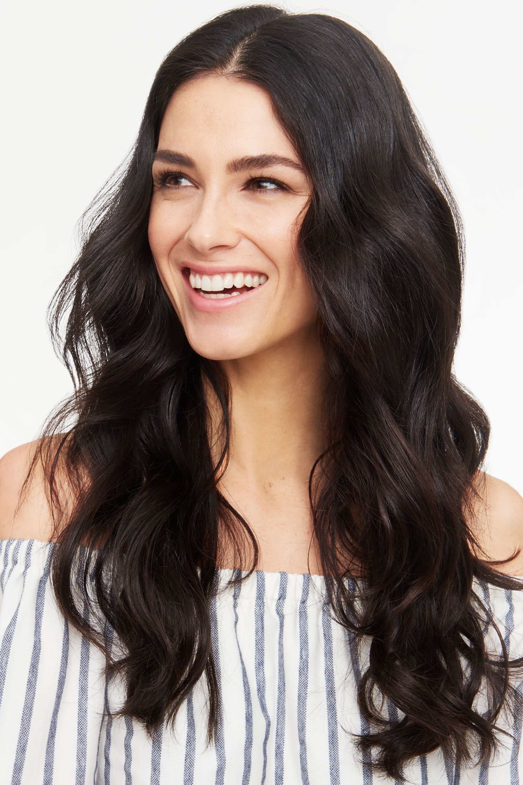 """<p>For a polished and relaxed style, do a blowout, then wrap one-inch sections of your hair around a curling wand, making sure not to overlap your strands. After you release the hair, loosen it up with your fingers. For this much fullness, use a volumizing collection like <a href=""""http://bit.ly/1XyoSPb"""" target=""""_blank"""">Suave Sea Mineral Infusion Shampoo and Conditioner</a> before you blow-dry. </p>"""