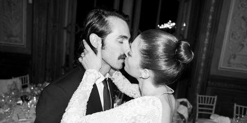 Event, Photograph, Outerwear, Happy, Coat, Suit, Monochrome, Kiss, Bridal clothing, Romance,