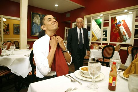 <p>Tucking in his napkin during his visit at Dooky Chase restaurant in New Orleans in 2008</p>