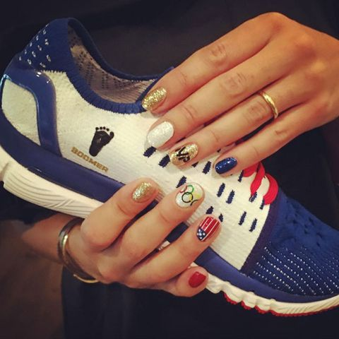 """<p>Michael Phelps' fiancé posted this snap on <a href=""""https://www.instagram.com/p/BIu785UA0cL/?taken-by=nicole.m.johnson&hl=en"""">Instagram</a>, thanking her manicurist, Nina, for her fly tips. (Look closely and you'll see flags, Olympic rings, and her future hubby's initials.)</p>"""