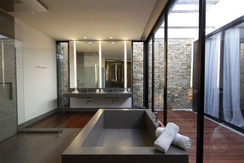 <p>The modern style of this penthouse makes a super-chic and sexy glass paneled bathroom feel right at home, and not overwrought.</p>