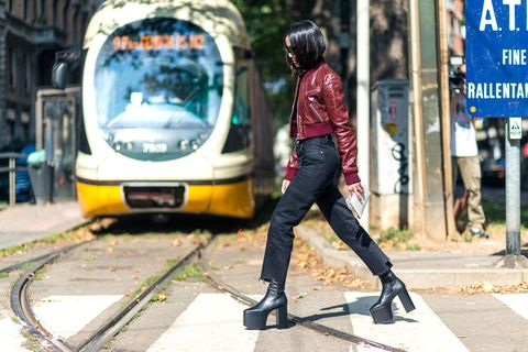 "<p>Yoyo is one of my favorite bloggers to shoot. She is wearing another hero of the season, the Balenciaga platform boots, crossing the street as the tram approaches the 100s of photographers in Milan.<span class=""redactor-invisible-space"" data-verified=""redactor"" data-redactor-tag=""span"" data-redactor-class=""redactor-invisible-space""></span></p>"