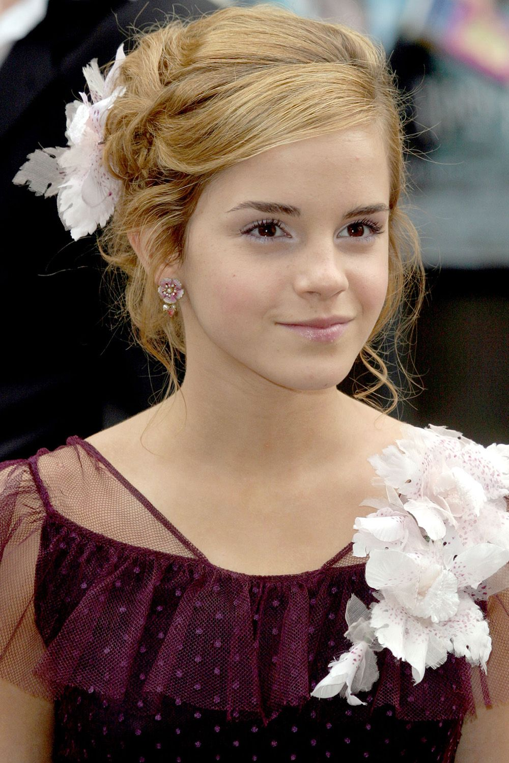 <p>A flower pin to match her dress in 2004.</p>