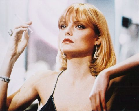 """<p>The ultimate bad-girl style and beauty icon: Michelle Pfeiffer as Elvira Hancock in the 1983 film <em data-redactor-tag=""""em"""" data-verified=""""redactor"""">Scarface</em>. Her haircut is iconic:a sleek bob with bangs and flipped ends.</p>"""